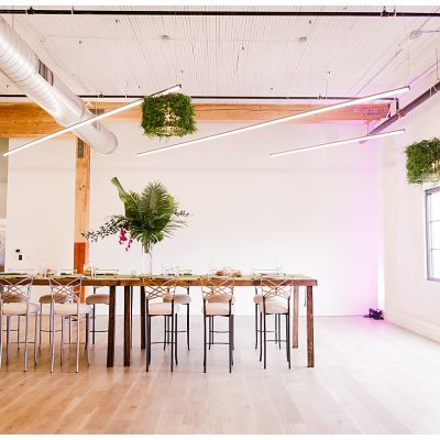 The grassaliere chandelier is a custom creation by LightSmiths that allows you to wrap a drum light with real or faux greenery and florals.